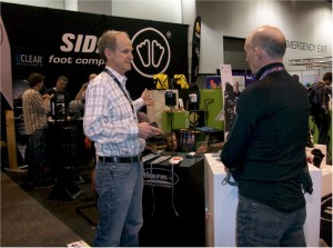 Rick talks to Jay at the Sidas booth regarding Therm-IC product for 2013 - 2014