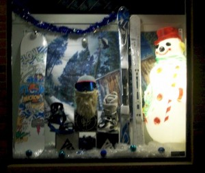 Frosty the Snowman eyes our new Skis and Snowboards